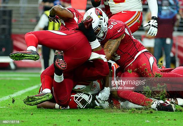 Running back Jamaal Charles of the Kansas City Chiefs is tacked by middle linebacker Larry Foote of the Arizona Cardinals and free safety Rashad...
