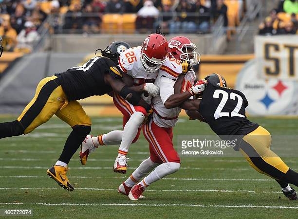 Running back Jamaal Charles of the Kansas City Chiefs is tackled by linebacker Sean Spence of the Pittsburgh Steelers as wide receiver Frankie...