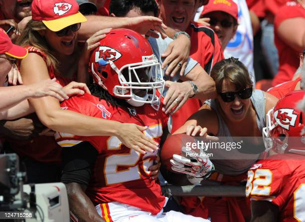 Running back Jamaal Charles of the Kansas City Chiefs jumps into the stands after scoring a touchdown against the Buffalo Bills during the second...