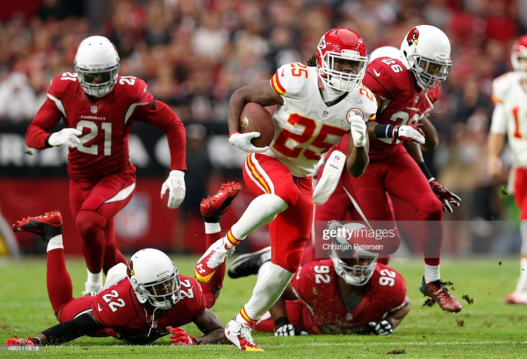 Running back Jamaal Charles #25 of the Kansas City Chiefs runs for a 63 yard touchdown past Strong safety Tony Jefferson #22 of the Arizona Cardinals (left) and Nose tackle Dan Williams #92 during the first quarter of the NFL game at the University of Phoenix Stadium on December 7, 2014 in Glendale, Arizona.