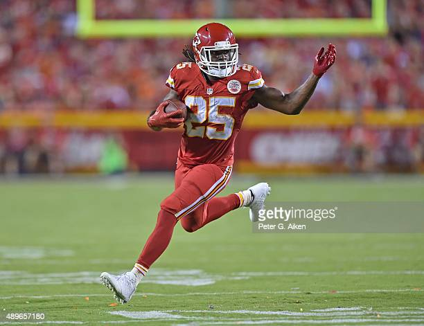 Running back Jamaal Charles of the Kansas City Chiefs runs up field against the Denver Broncos during the first half at Arrowhead Stadium on...
