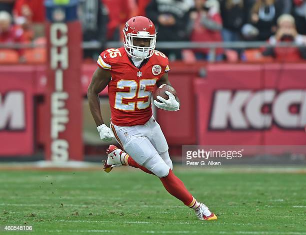 Running back Jamaal Charles of the Kansas City Chiefs runs with the ball against the Oakland Raiders during the first half on December 14, 2014 at...