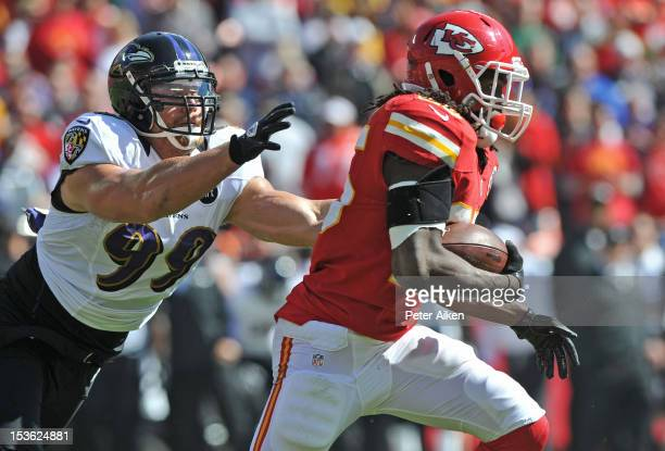 Running back Jamaal Charles of the Kansas City Chiefs rushes past linebacker Paul Kruger of the Baltimore Ravens during the first quarter on October...