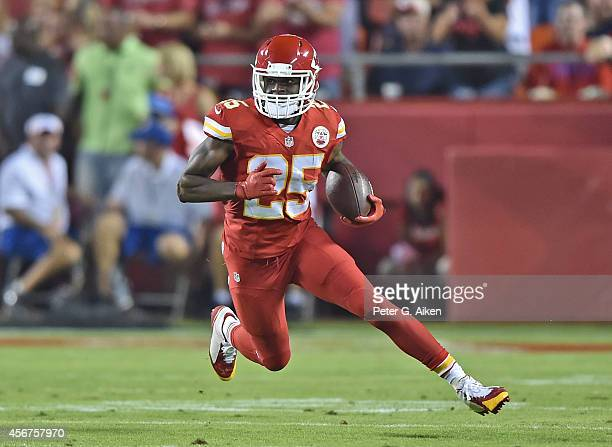 Running back Jamaal Charles of the Kansas City Chiefs rushes up field against the New England Patriots during the first half on September 29, 2014 at...