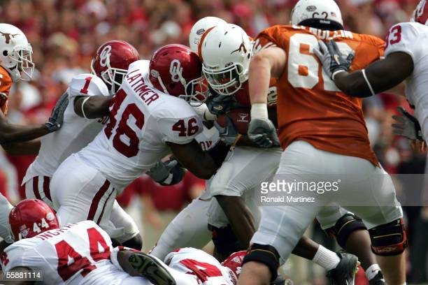 Running back Jamaal Charles of the Texas Longhorns breaks away from Zach Latimer of the Oklahoma Sooners and runs for a touchdown on October 8, 2005...