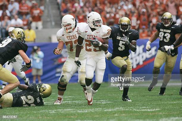 Running back Jamaal Charles of the Texas Longhorns carries the ball against the Colorado Buffaloes during the Dr. Pepper Big 12 Championship at...