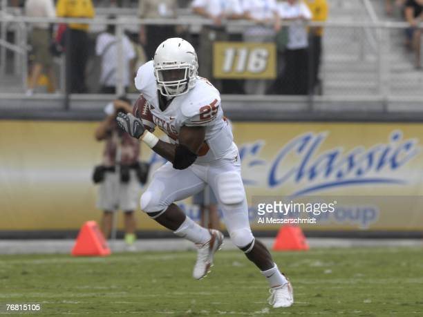 Running back Jamaal Charles of the Texas Longhorns rushes upfield against the University of Central Florida Knights at Bright House Networks Stadium...