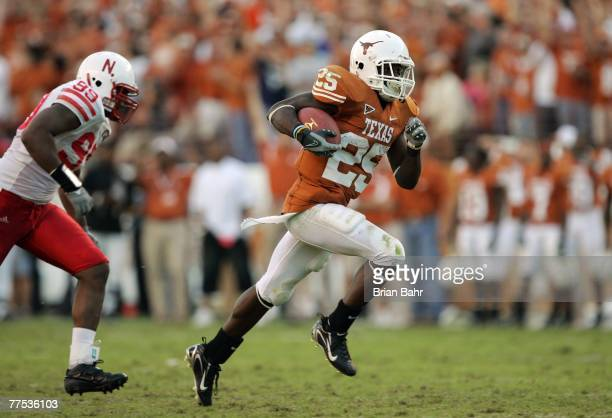 Running back Jamaal Charles of the Texas Longhorns sprints to a 40yard touchdown ahead of defensive end Barry Turner of the Nebraska Cornhuskers at...