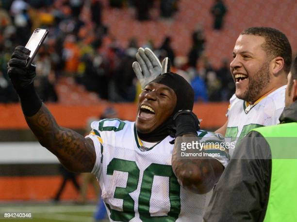 Running back Jamaal Williams and left guard Lane Taylor of the Green Bay Packers celebrate on the field after a game on December 10 2017 against the...