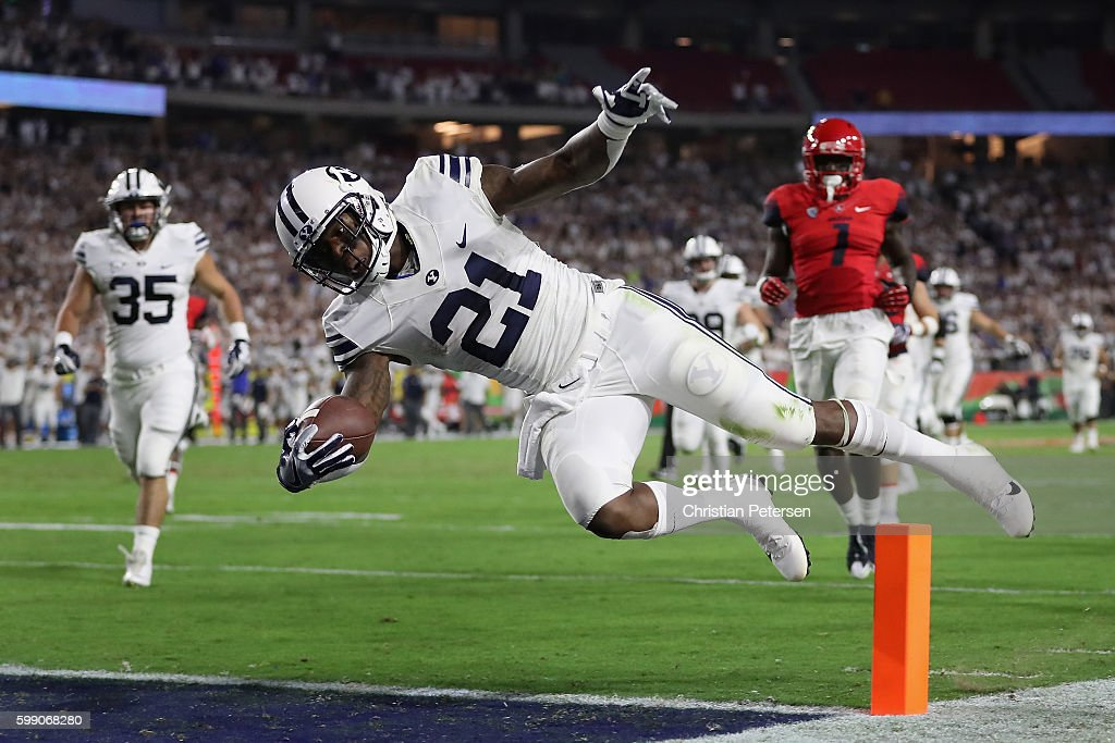 Running back Jamaal Williams #21 of the Brigham Young Cougars falls into the end zone after a 33 yard rush during the first half of the college football game against the Arizona Wildcats at University of Phoenix Stadium on September 3, 2016 in Glendale, Arizona. The play was called back because of an illegal block on the offense.