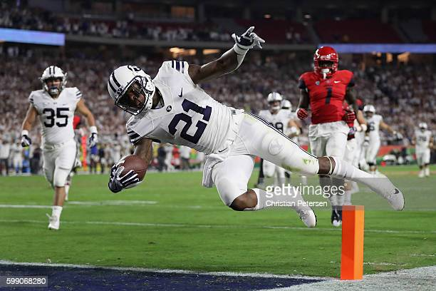 Running back Jamaal Williams of the Brigham Young Cougars falls into the end zone after a 33 yard rush during the first half of the college football...