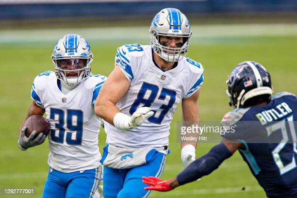 Running back Jamal Agnew runs behind the blocking of tight end Jesse James of the Detroit Lions during a game against the Tennessee Titans at Nissan...