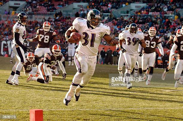 Running back Jamal Lewis of the Baltimore Ravens Breaks into the open field for a fourth quarter touchdown against the Cleveland Browns on December...