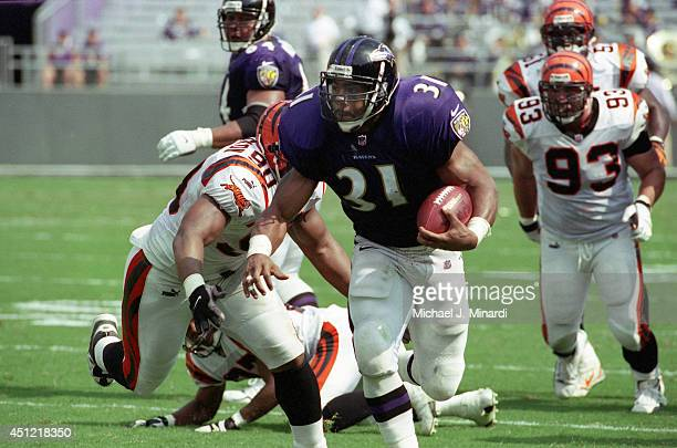 Running back Jamal Lewis of the Baltimore Ravens breaks through the line for a few extra key yards during a NFL game against the Cincinnati Bengals...