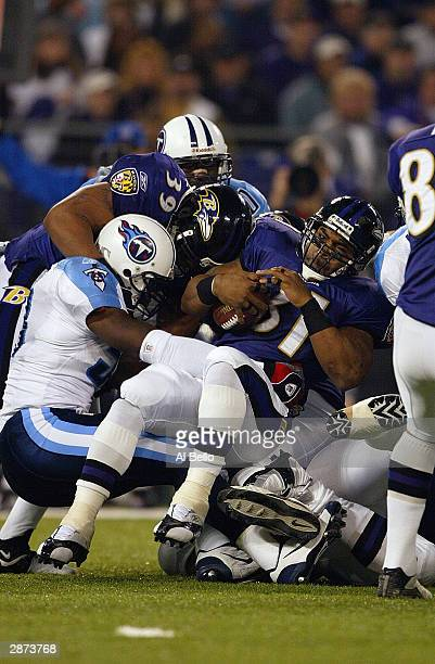 Running back Jamal Lewis of the Baltimore Ravens gets taken down by a Tennessee Titans defender during the AFC Wildcard playoff game at M T Bank...