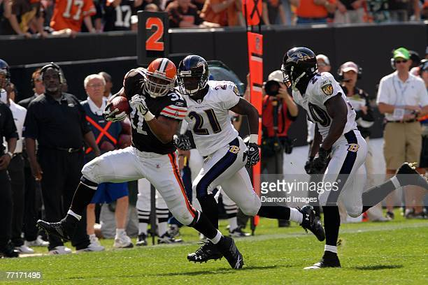 Running back Jamal Lewis of the Cleveland Browns runs away from defensive backs Chris McAlister and Ed Reed of the Baltimore Ravens on a 28yard run...