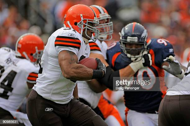 Running back Jamal Lewis of the Cleveland Browns rushes against the Denver Broncos during NFL action at Invesco Field at Mile High on September 20...