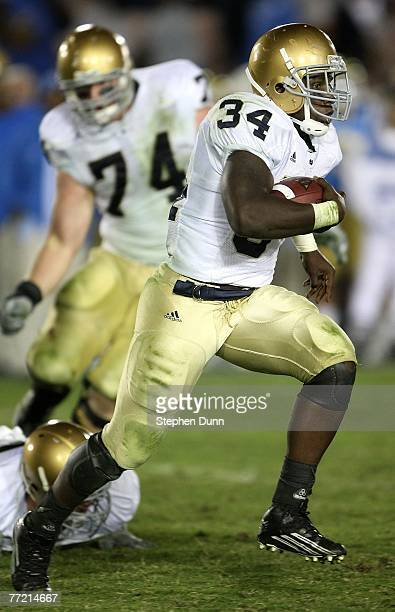 Running back James Aldridge of the Notre Dame Fighting Irish carries the ball against the UCLA Bruins at the Rose Bowl October 6, 2007 in Pasadena,...