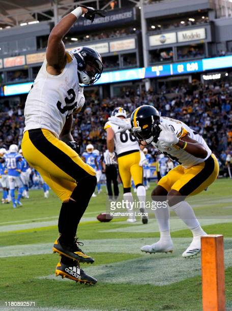 Running back James Conner and wide receiver JuJu Smith-Schuster of the Pittsburgh Steelers celebrate a touchdown in the second quarter against the...