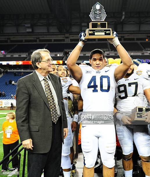 Running back James Conner of the Pittsburgh Panthers celebrates after being named offensive MVP after a game against the Bowling Green Falcons during...