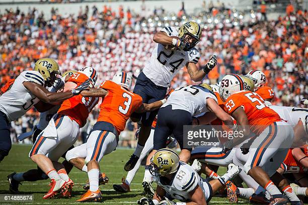 Running back James Conner of the Pittsburgh Panthers dives into the end zone during the Panthers' game against the Virginia Cavaliers at Scott...