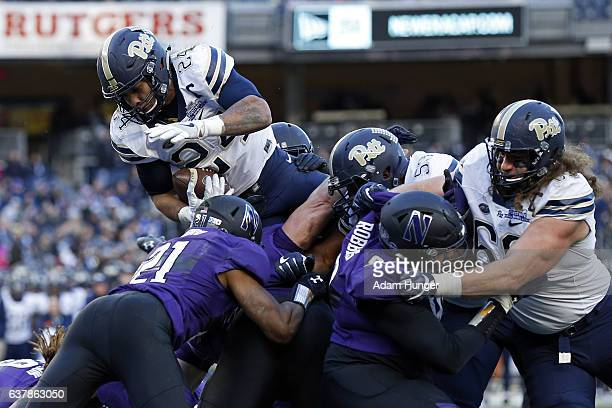 Running back James Conner of the Pittsburgh Panthers is stopped trying to score a touchdown against the Northwestern Wildcats during the New Era...