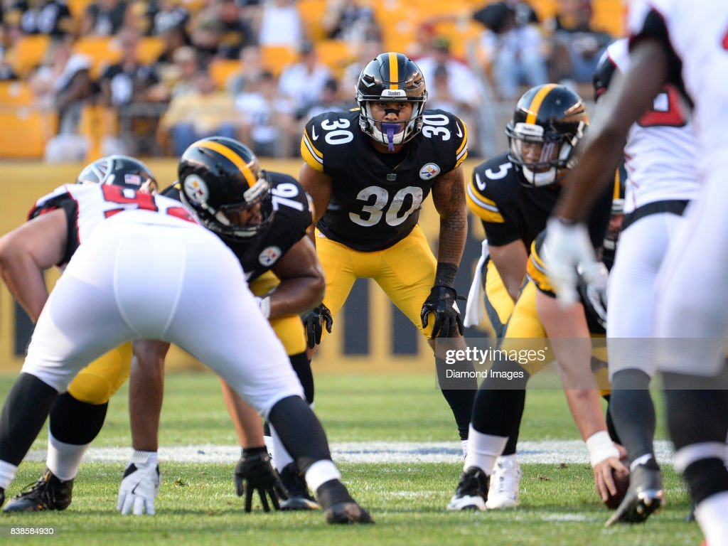 Running back James Conner #30 of the Pittsburgh Steelers awaits the snap from his position in the third quarter of a preseason game on August 20, 2017 against the Atlanta Falcons at Heinz Field in Pittsburgh, Pennsylvania. Pittsburgh won 17-13.