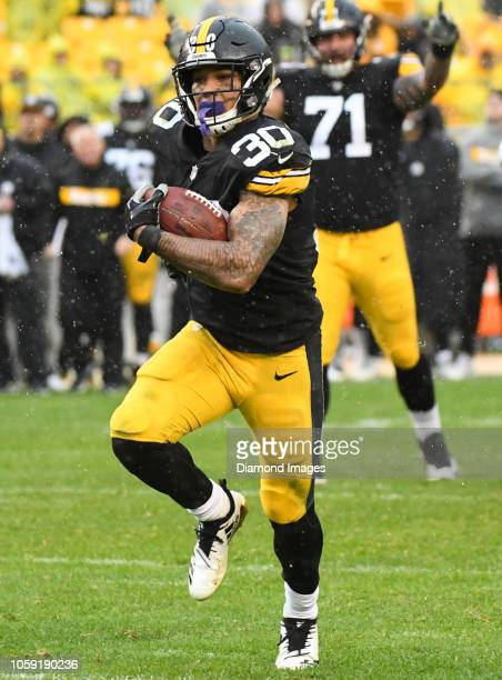 Running back James Conner of the Pittsburgh Steelers carries the ball in the fourth quarter of a game against the Cleveland Browns on October 28 2018...