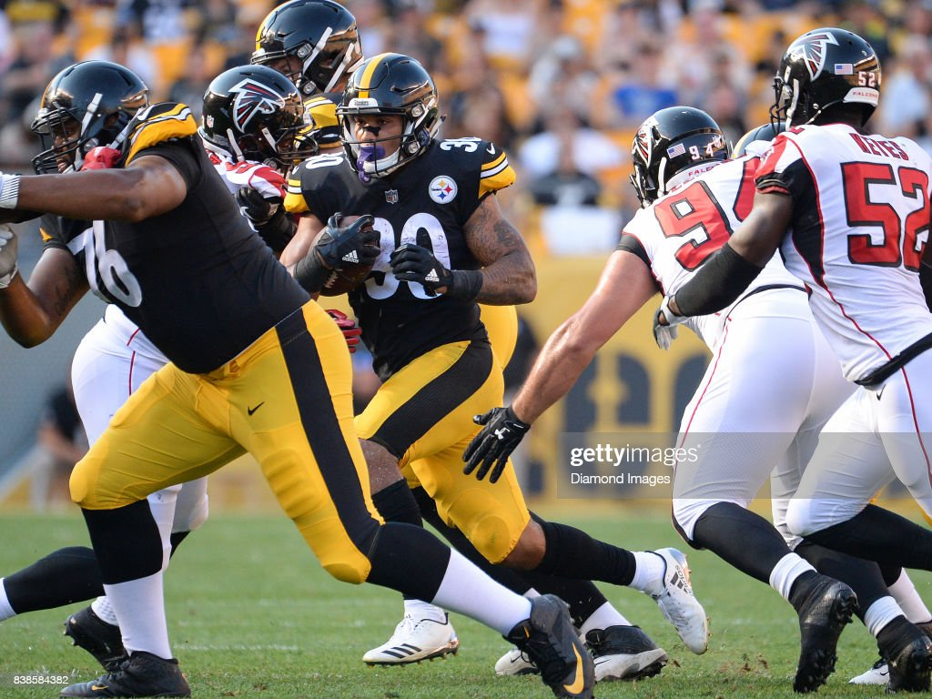 Running back James Conner #30 of the Pittsburgh Steelers carries the ball in the third quarter of a preseason game on August 20, 2017 against the Atlanta Falcons at Heinz Field in Pittsburgh, Pennsylvania. Pittsburgh won 17-13.