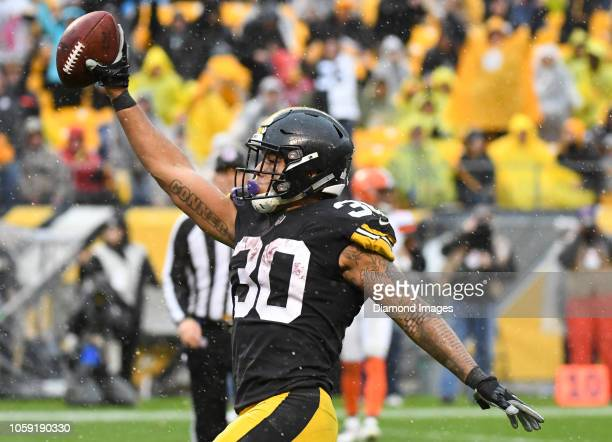 Running back James Conner of the Pittsburgh Steelers celebrates after scoring a rushing touchdown in the fourth quarter of a game against the...