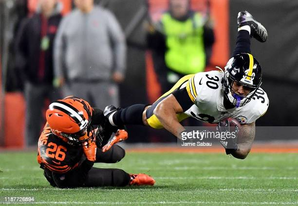 Running back James Conner of the Pittsburgh Steelers is tackled by cornerback Greedy Williams of the Cleveland Browns at FirstEnergy Stadium on...