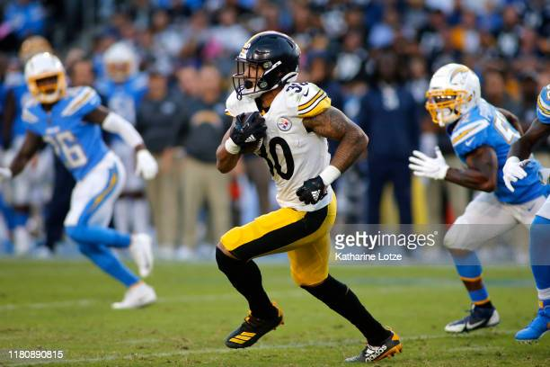 Running back James Conner of the Pittsburgh Steelers runs the ball down the field during the second quarter against the Los Angeles Chargers at...