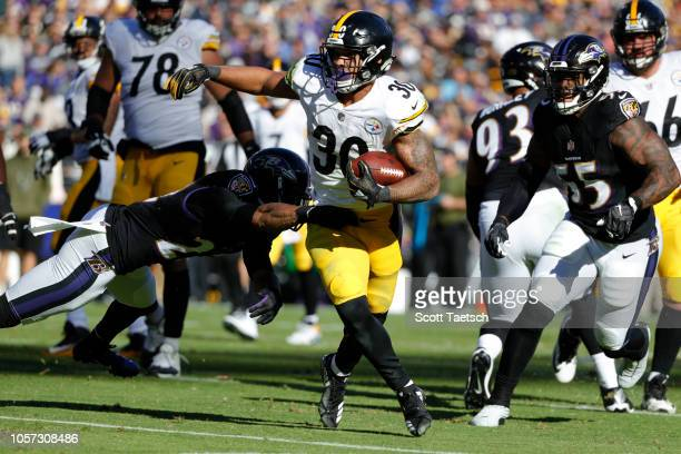 Running Back James Conner of the Pittsburgh Steelers runs with the ball in the second quarter against the Baltimore Ravens at MT Bank Stadium on...
