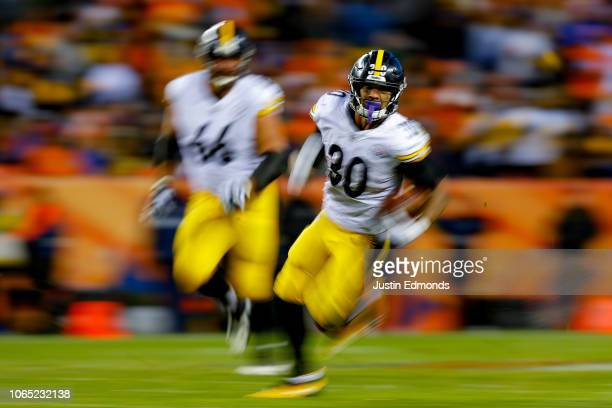 Running back James Conner of the Pittsburgh Steelers rushes against the Denver Broncos during the third quarter of a game at Broncos Stadium at Mile...