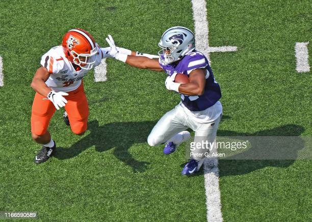 Running back James Gilbert of the Kansas State Wildcats rushes down field against defensive back Jerry McBride III of the Bowling Green Falcons...