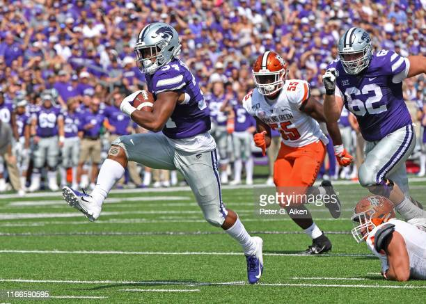 Running back James Gilbert of the Kansas State Wildcats rushes for a touchdown against the Bowling Green Falcons during the first half at Bill Snyder...