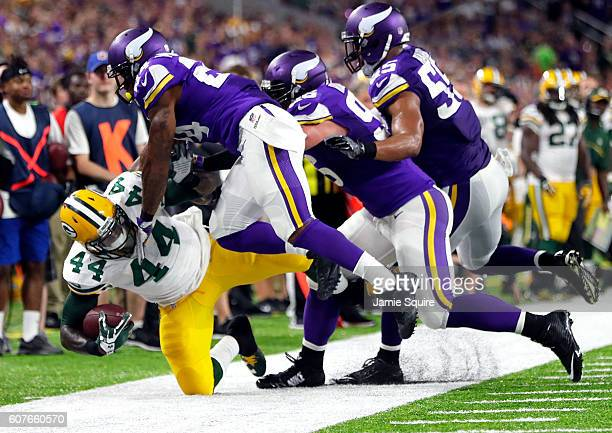 Running back James Starks of the Green Bay Packers is forced out of bounds by the Minnesota Vikings defense during the game on September 18 2016 in...