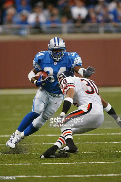 Running back James Stewart of the Detroit Lions tries to avoid being tackled by safety Mike Brown of the Chicago Bears during the NFL game at Ford...