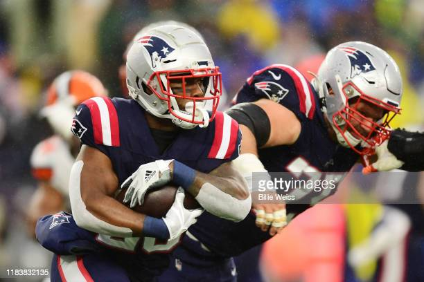 Running back James White of the New England Patriots carries the ball in the second quarter of the game against the Cleveland Browns at Gillette...