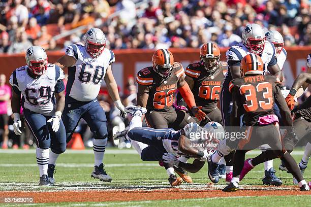 Running back James White of the New England Patriots runs a play during the first half against the Cleveland Browns at FirstEnergy Stadium on October...