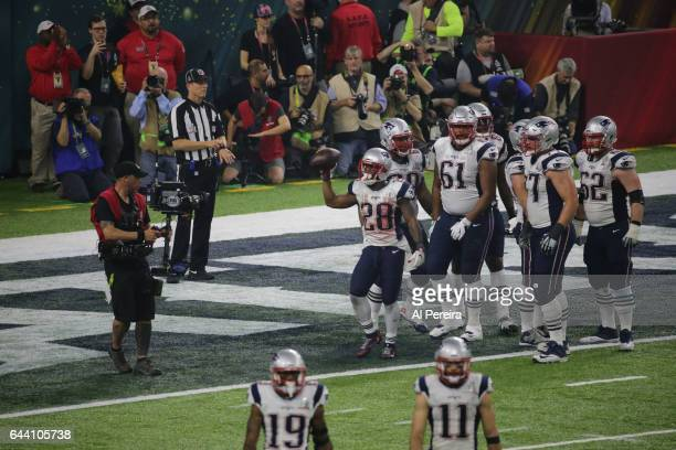 Running Back James White of the New England Patriots scores a Two-point conversion during the Super Bowl LI between the New England Patriots and...