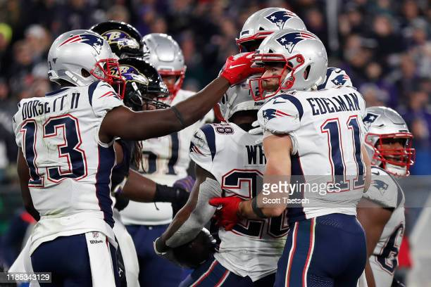 Running back James White of the New England Patriots scores and celebrates a third quarter touchdown against the Baltimore Ravens at M&T Bank Stadium...