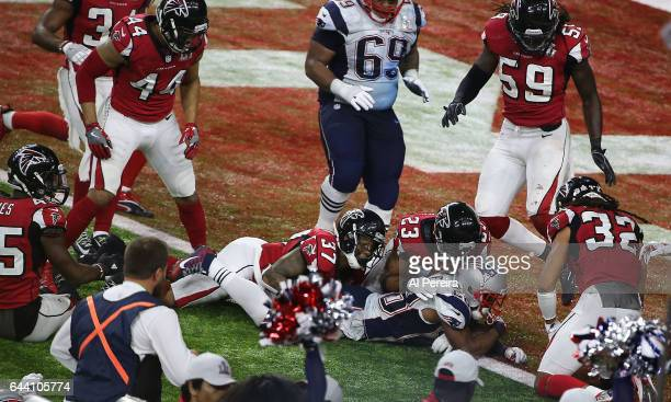 Running Back James White of the New England Patriots scores the Game Winning Touchdown in Overtime during the Super Bowl LI between the New England...