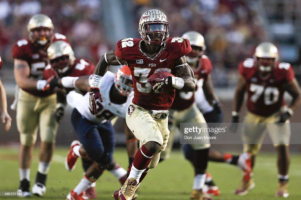 Running back James Wilder, Jr. #32 of the Florida State Seminoles makes a running play during the game against the Syracuse Orange at Doak Campbell Stadium on Bobby Bowden Field on November 16, 2013 in Tallahassee, Florida. No. 2 Florida State beat Syracuse 59 to 3.