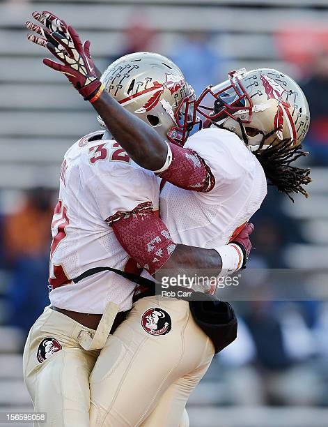 Running back James Wilder Jr #32 of the Florida State Seminoles celebrates with teammate Greg Dent after scoring a rushing touchdown during the...