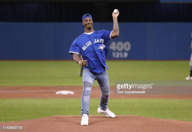 CFL running back James Wilder throws out the first pitch before the Toronto Blue Jays MLB game against the Tampa Bay Rays at Rogers Centre on April...