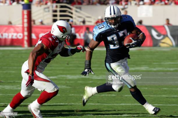 Running back Jarrett Payton of the Tennessee Titans tries to get around David Macklin of the Arizona Cardinals during the fourth quarter at Sun Devil...