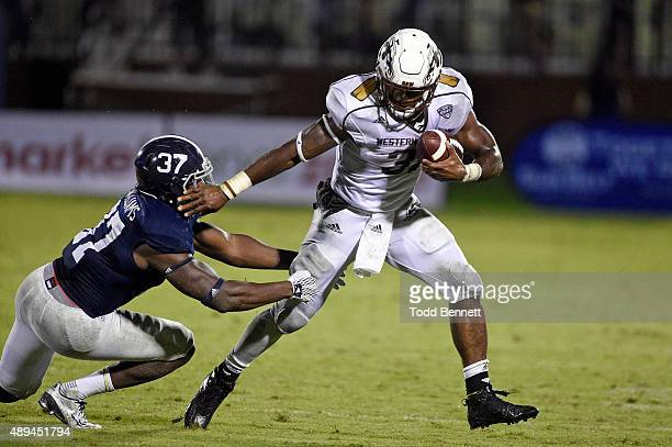 Running back Jarvion Franklin of the Western Michigan Broncos tries to break a tackle by linebacker Antwione Williams of the Georgia Southern Eagles...