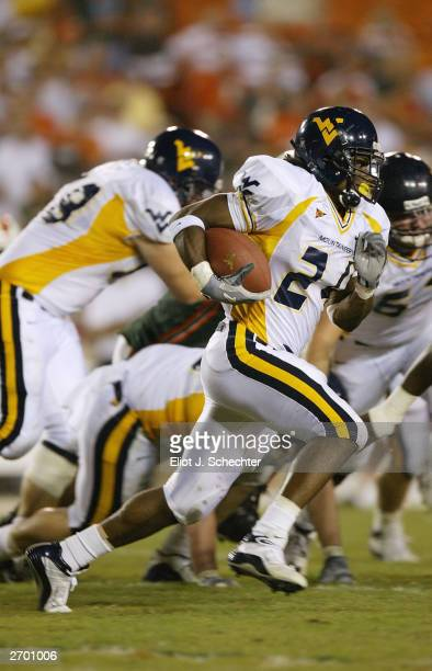 Running back Jason Colson of the West Virgina Mountaineers runs for a first down against the University of Miami Hurricanes on October 2 2003 at The...
