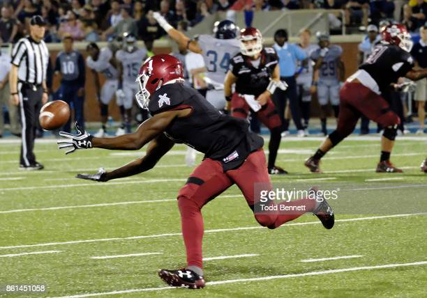 Running back Jason Huntley of the New Mexico State Aggies pulls in a reception against the Georgia Southern Eagles at Paulson Stadium on October 14...